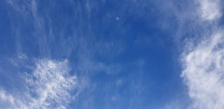 beautiful bright white clouds on a blue sky, fluffy white clouds on a sunny day