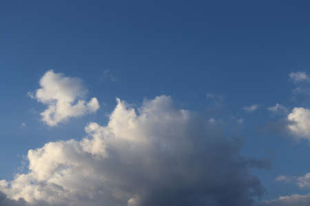 beautiful white and gray clouds on a blue sky, fluffy white gray clouds on a sunny day