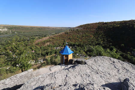 prayer house on top of a green hill
