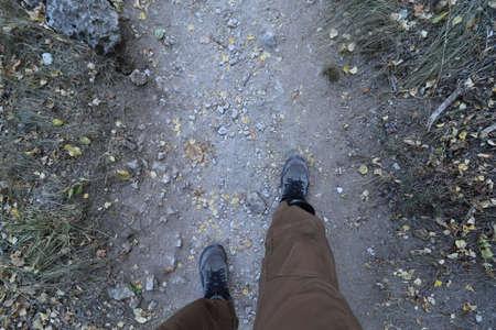 walk the dusty trail, feet walk forward on the road 版權商用圖片