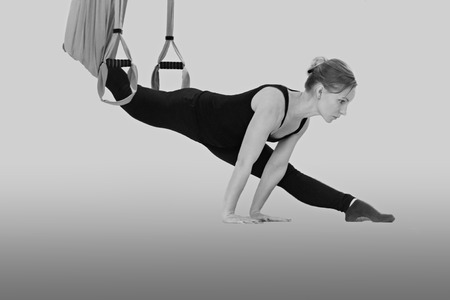 trapeze: Girl is Engaged in Stretching