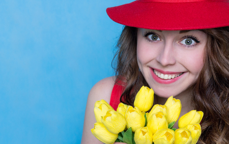 pretty brunette woman: Bright Young Woman with a Bouquet of Flowers. Copy Space. Spring Concept Stock Photo