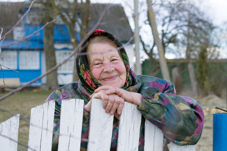 Elderly Woman Smiling in the Village Stock Photo