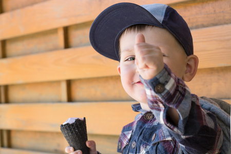 licking finger: A Child with an Ice Cream Shows a Finger Stock Photo