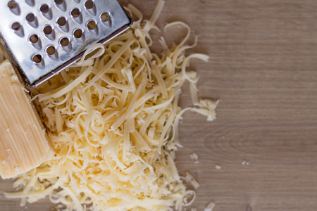 metal grater: Cheese with a Grater. Copy Space