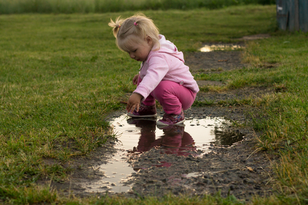 unruly: Portrait of a Child in a Dirty Puddle