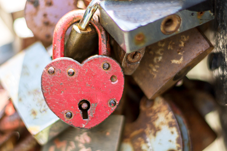 Rusty Heart. Hinged Lock in the Shape of the Heart Stock Photo