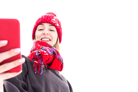 Woman in warm Things with Mobile in Hands. Winter Concept