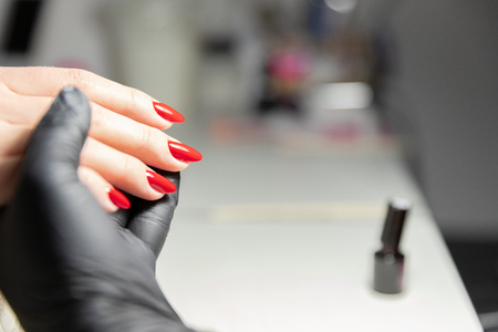 The process of creating the perfect red manicure. Womens Concept. Beauty. Imagens