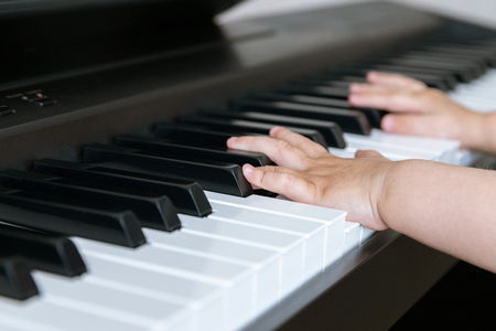 Children's Hands on the Piano Keys. Musical Learning. Education. Childhood. Background