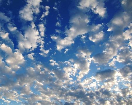 Glowing Clouds in a Blue Sky