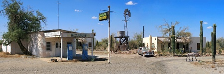 Aprox. 30 photographs were merged to create this great looking vintage service station. It has southwest u.s.a. look with cactuses, a donkey,water tower and vintage blue colored gas pumps to go along with vintage white adobe style buildings. Panorama.