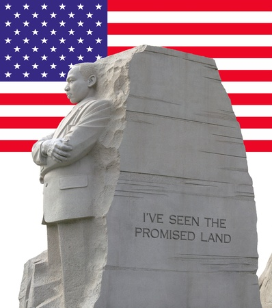 promised: Left side view of king memorial with the American flag as a background. Editorial