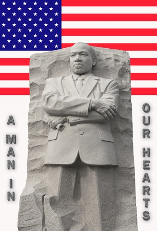 Frontal view of Martin Luther King Memorial with american flag as a back drop in upper third of photo.
