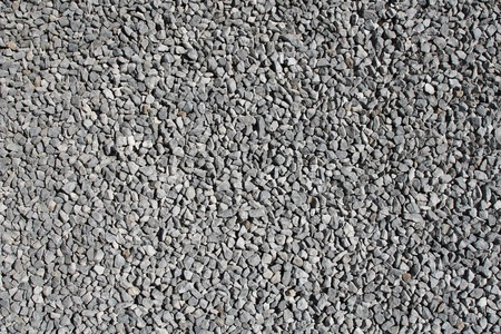Texture, landscape style photo of three quarter minus crushed rock, compacted and leveled