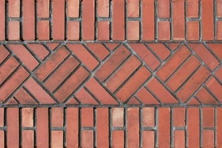 grunge textures: Unusual vintage brick wall pattern  Herring bone pattern squares amidst vertical pattern top and bottom