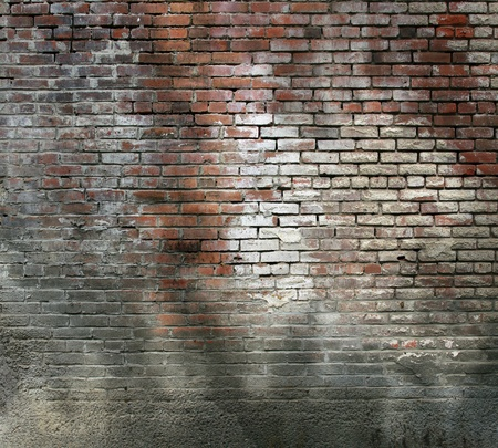 caked: Really grungy brick look with lots of old mortar residue caked across the surface. Stock Photo