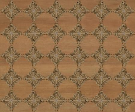 inlay: Wood tile with darker diamond butterfly pattern inlay  Dark black walnut coloring  Stock Photo