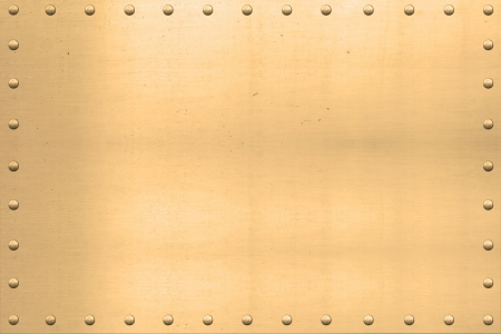 plated:  Vintage gold plated sheet, showing scars and scratches, with riveted edges. Stock Photo