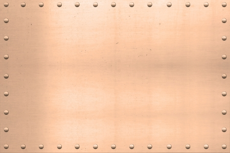 riveted metal:  Vintage copper plated sheet, showing scars and scratches, with riveted edges.