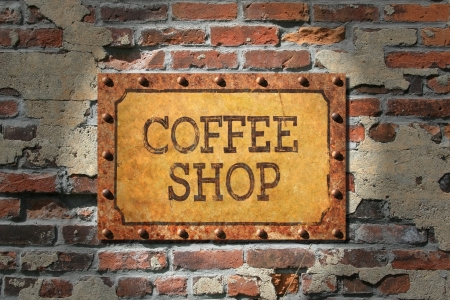vintage photo:  Coffee shop painted sign on heavily rusted metal plate, with rusted, riveted edges.That, on a very old brick wall.