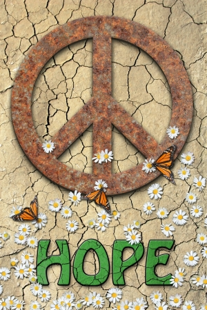 Rusted peace symbol, daisys, butterflys, and the word hope,green colored in center text. Background of dry cracked earth. photo