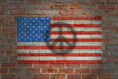 American flag painting on brick wall with a peace sign shadow atop. photo