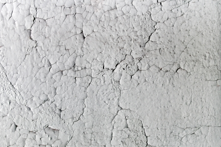 Aged, cracking, and textured white paint on an old wall  Stock Photo - 13918606