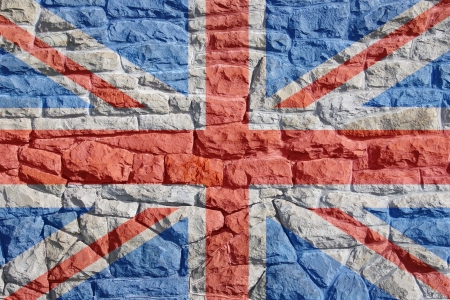 Union jack, british flag layered atop a rock and mortar wall giving a painted on appearance  Stock Photo