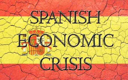 Faded, cracked, and aged texture, spanish flag, with the words spanish economic crisis, which has a dark metallic chiseled look