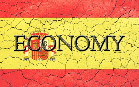 chiseled: Faded, cracked, and aged texture, spanish flag, with the word economy  which has a dark metallic chiseled look