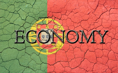 Faded, cracked, and aged texture, portuguese flag, with the word economy  which has a dark metallic chiseled look