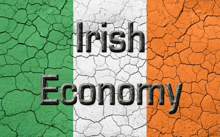 irish cities: Faded, cracked, and aged texture, Ireland flag, with the words Irish Economy, in a  dark metallic chiseled look.