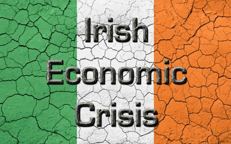 chiseled: Faded, cracked, and aged texture, Ireland flag, with the words Irish Economic Crisis, in a  dark metallic chiseled look.  Stock Photo