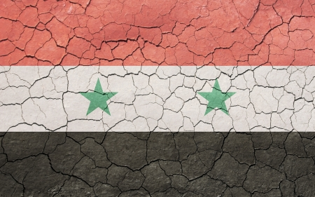 Faded, cracked, and aged texture, syrian flag. photo
