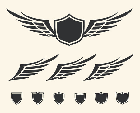 Vector set of isolated winged crests over white background  Vector