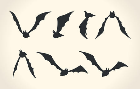 flight: Bat silhouettes in a different poses, Halloween vector illustration over white background