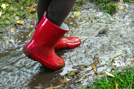 Red boots in the water. photo