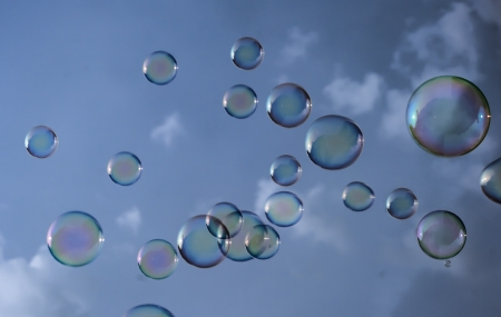 blowing soap bubbles in the sky and clouds
