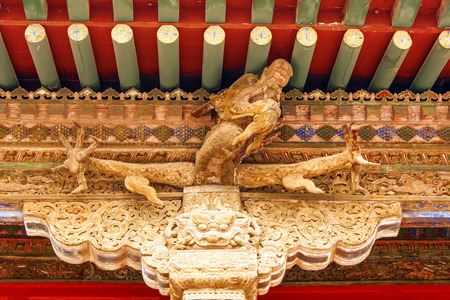 ornately: Ornately painted beams in the Forbidden City Shenyang Beijing China