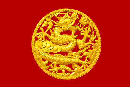 Golden Chinese dragon on red wood background photo