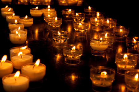 funeral background: Romantic glowing long row of candlelight burning