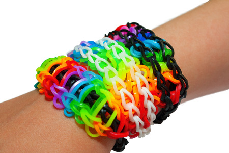 Bracelet made of colorful rainbow loom rubber bands photo