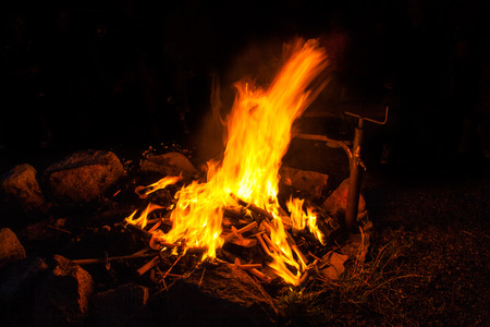 warm and romantic campfire burning torches photo