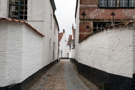 abandoned narrow street in the Beguinage Kortrijk