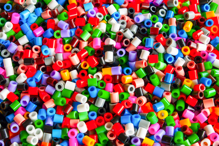 multicolored plastic hama beads toy for kids photo