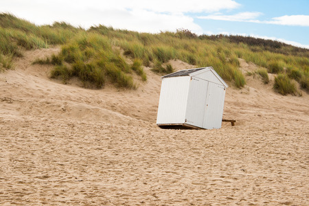 overthrown: beach cabin overthrown by a storm Stock Photo