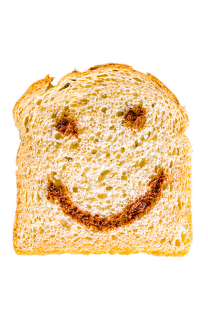 a slice of bread with nutella smile