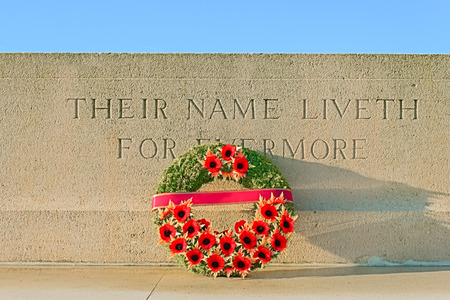 monument world war one with wreath of poppies photo