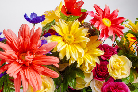 a detail of colorful fabric flowers photo